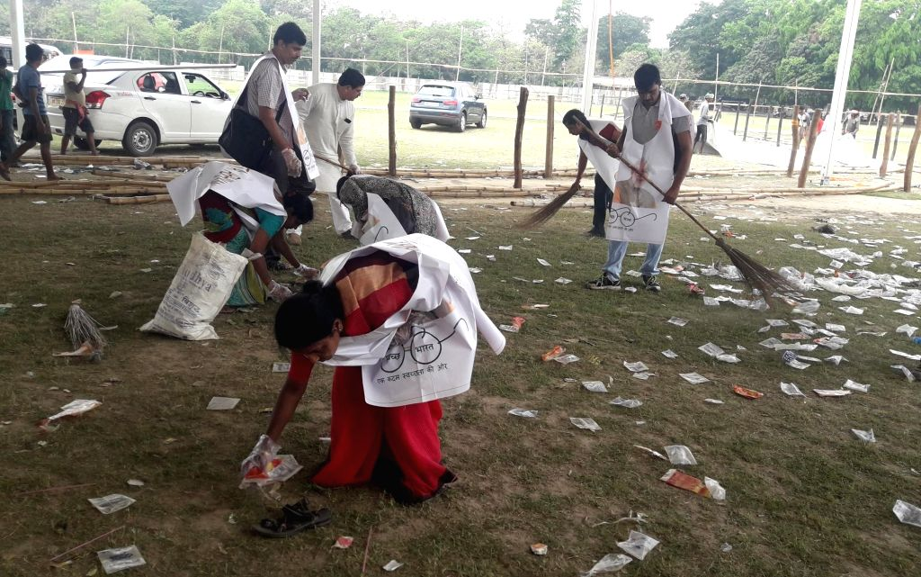 Kolkata:  A day after Prime Minister Narendra Modi's mega rally at the Brigade Parade Ground, BJP workers carry out a 'Swachh Bharat' cleanliness drive at the ground, in Kolkata on April 4, 2019. Over 200 BJP workers on Thursday conducted the cleanli - Narendra Modi