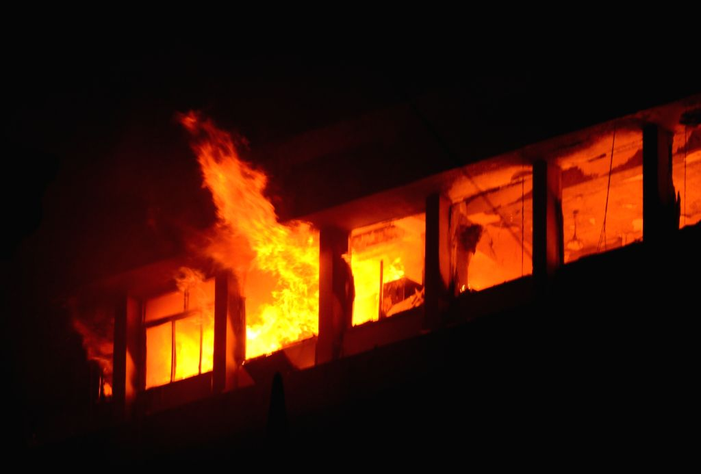 Kolkata: A fire broke out on the 13th floor of a multi-storeyed building, housing offices of the Railways, on Strand Road in Kolkata on Mar 8, 2021.  (Photo: IANS/Kuntal Chakrabarty)