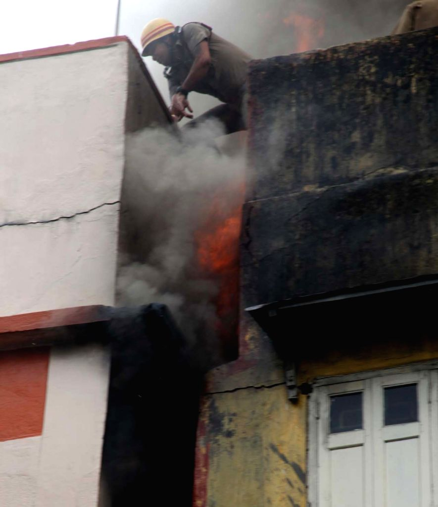 : Kolkata: A firefighter at the godown that caught fire, in Kolkata on May 23, 2018. (Photo: IANS).