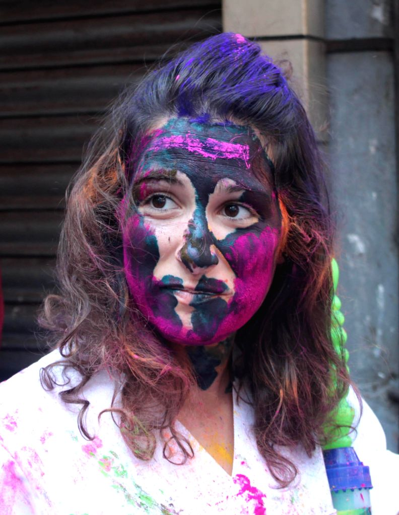 A foreigner plays holi on the streets of Kolkata on March 5, 2015.