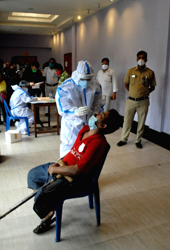 Kolkata : A health worker wearing a PPE suit collects swab samples for COVID-19 testing, in Kolkata on July 30, 2020.