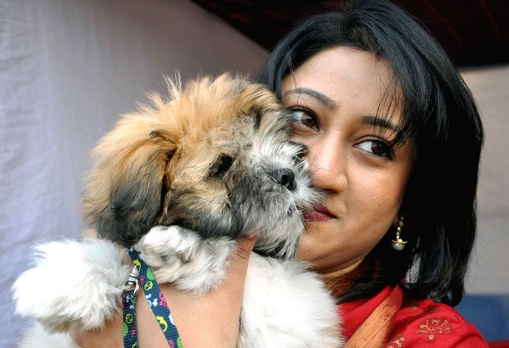 A lady with her pet at a dog show organised at Salt Lake central park in Kolkata, on Jan 25, 2015.