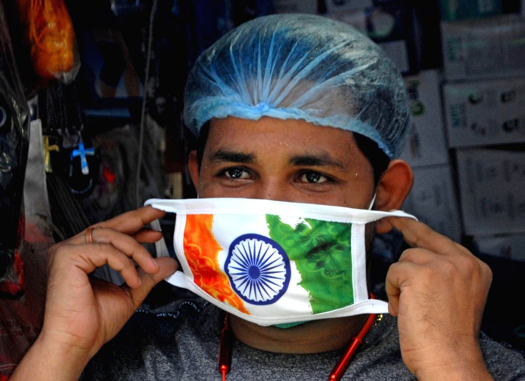 Kolkata : A man seen wearing a tricolored face mask on the occasion of the 74th Independence Day, amid COVID-19 pandemic in Kolkata on Aug 15, 2020.