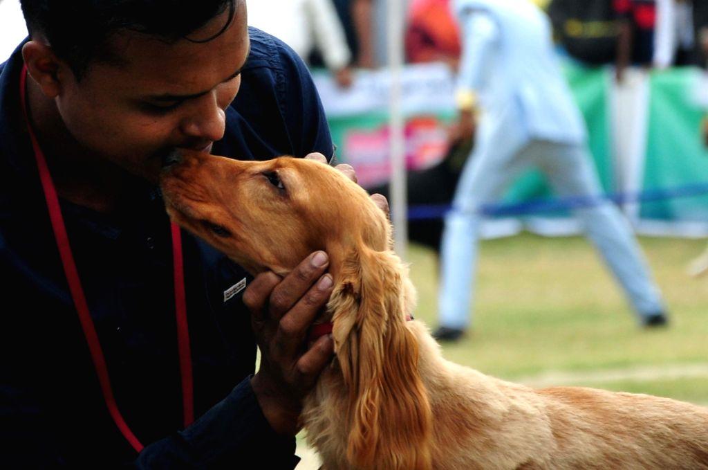 Kolkata: A man with his pet at a dog show organised by Calcutta Canine Club in Kolkata, on Dec 15, 2018. (Photo: IANS)