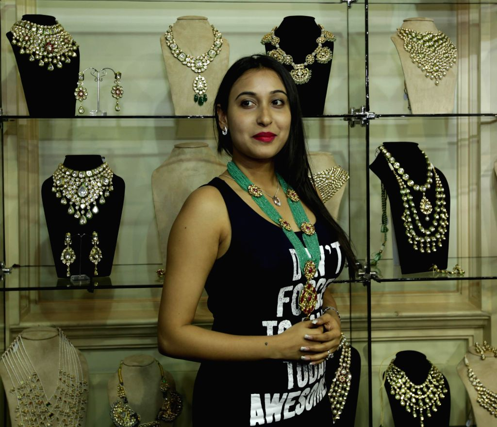 A model displays ornaments during the ``FireFlies`` Fashion and Lifestyle Exhibition in Kolkata on 14 March 2015.