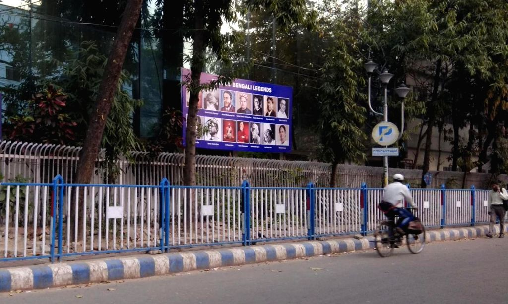 """Kolkata: A road side hoarding features West Bengal Chief Minister Mamata Banerjee's picture along with the """"Famous Bengali Legends"""" at Sector 5, Salt Lake City in Kolkata on March 7, 2019. (Photo: IANS) - Mamata Banerjee"""