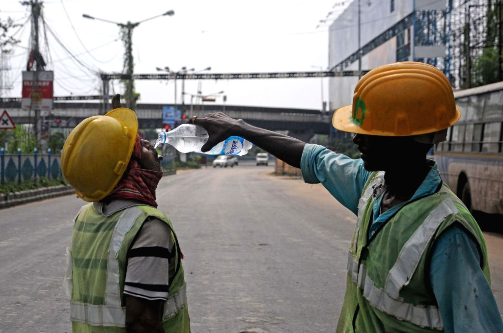 Kolkata : A sanitation worker being offered water by a coworker in the midst of work during a biweekly COVID-19 lockdown in Kolkata on Aug 31, 2020.
