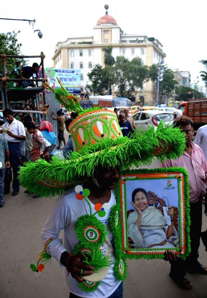 Kolkata : A Trinamool Congress worker holds a portraits of West Bengal Chief Minister and party supremo Mamata Banerjee on the eve of Martyr's Day, in Kolkata, on July 20, 2018. 21st July is observed ... - Mamata Banerjee