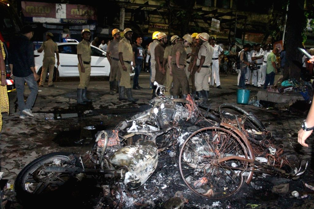 Kolkata: A view of three motorbikes which were set ablaze in the College Street area after Trinamool Congress Chhatra Parishad activists allegedly pelted stones at BJP President Amit Shah's roadshow triggering clashes, in Kolkata, on May 14, 2019. (P - Amit Shah