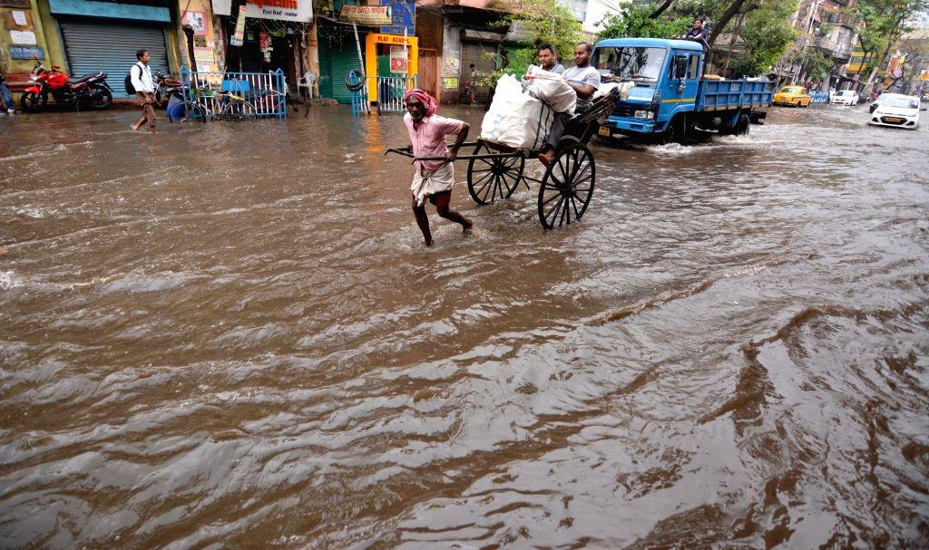 Kolkata: A view of waterlogged streets after heavy rains in Kolkata, on Feb 28, 2019. (Photo: Kuntal Chakrabarty/IANS)