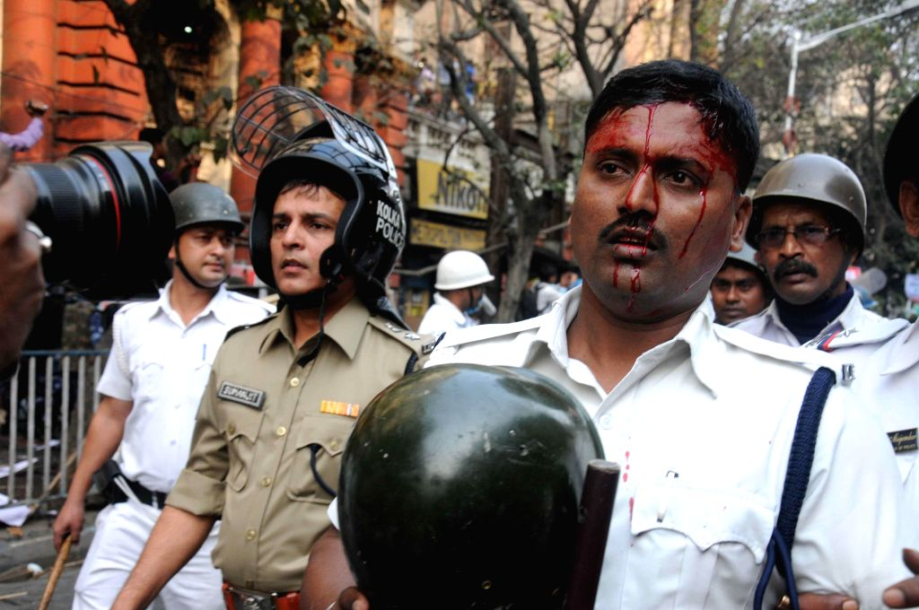 A West Bengal Police personnel injured during SUCI activists demonstrate against the West Bengal Government in Kolkata on Feb 5, 2015.