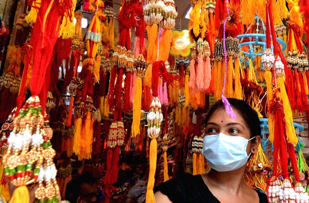 Kolkata : A woman busy shopping for Rasha Bandhan on the eve of the festival amid COVID-19 pandemic, in Kolkata on Aug 2, 2020.