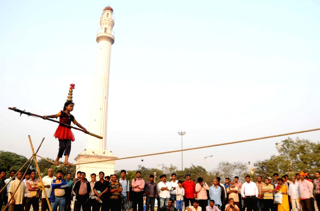 A young funambulist shows her skills near Shahid Minar in Kolkata on Dec 1, 2014. 
