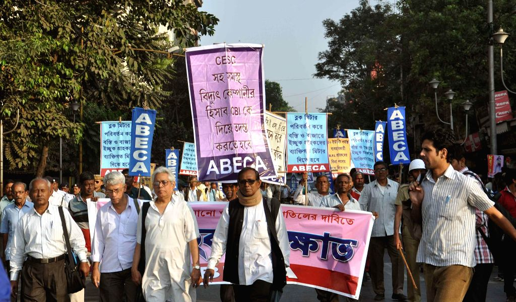 Activists of ABECA (All Bengal Electricity Consumer Association) protest against hike in electricity tariff in Kolkata, on Dec 2, 2014.