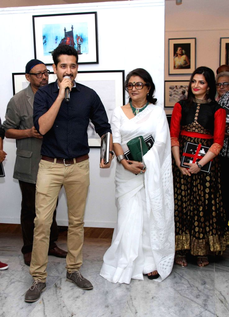 Actor and filmmaker Aparna Sen and Parambrata Chatterjee during a photography exhibition in Kolkata on 11 Nov 2014. - Parambrata Chatterjee