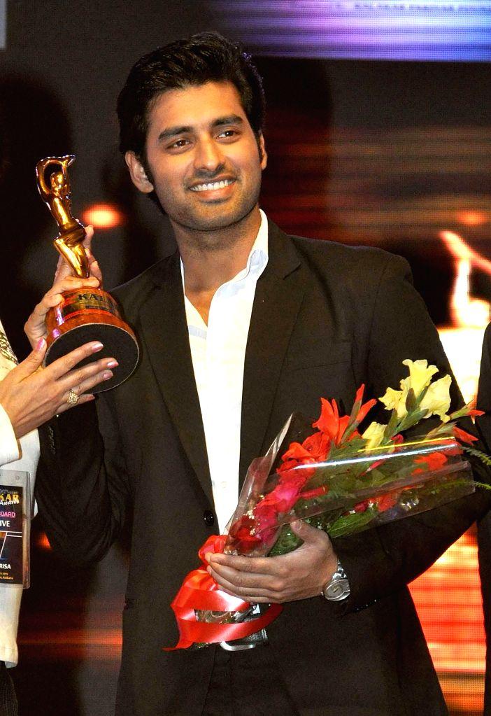 Actor Ankush Hazra receives Best Actor Award during the 23rd Kalakar Awards in Kolkata on Jan 11, 2014. - Ankush Hazra