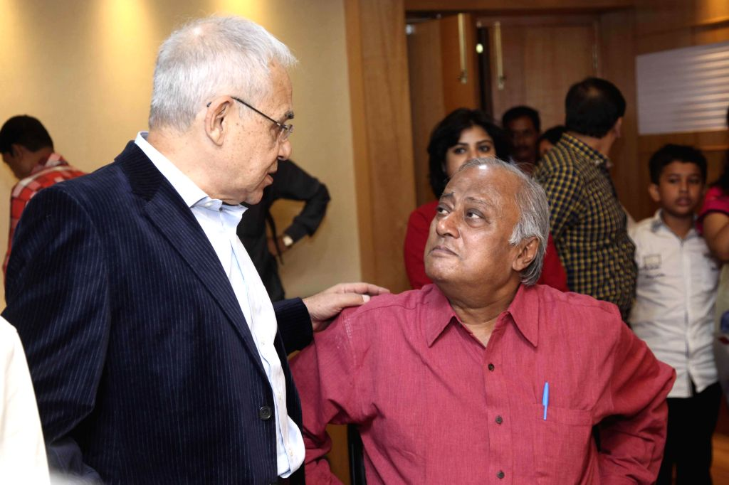 Actor Dhritiman Chatterjee and Trinamool Congress MP Saugata Roy during the premier of film `Shajarur Kanta` in Kolkata on March 20, 2015. - Dhritiman Chatterjee and Saugata Roy