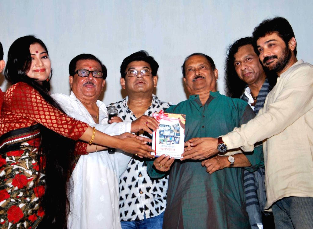 Actor Prosenjit Chatterjee with West Bengal panchayat minister Subrata Mukherjee, singer Amit Kumar and others at the launch of `Tochan Ghosh er Jalsha Ghar` - a book - in Kolkata on April ... - Prosenjit Chatterjee, Subrata Mukherjee and Amit Kumar