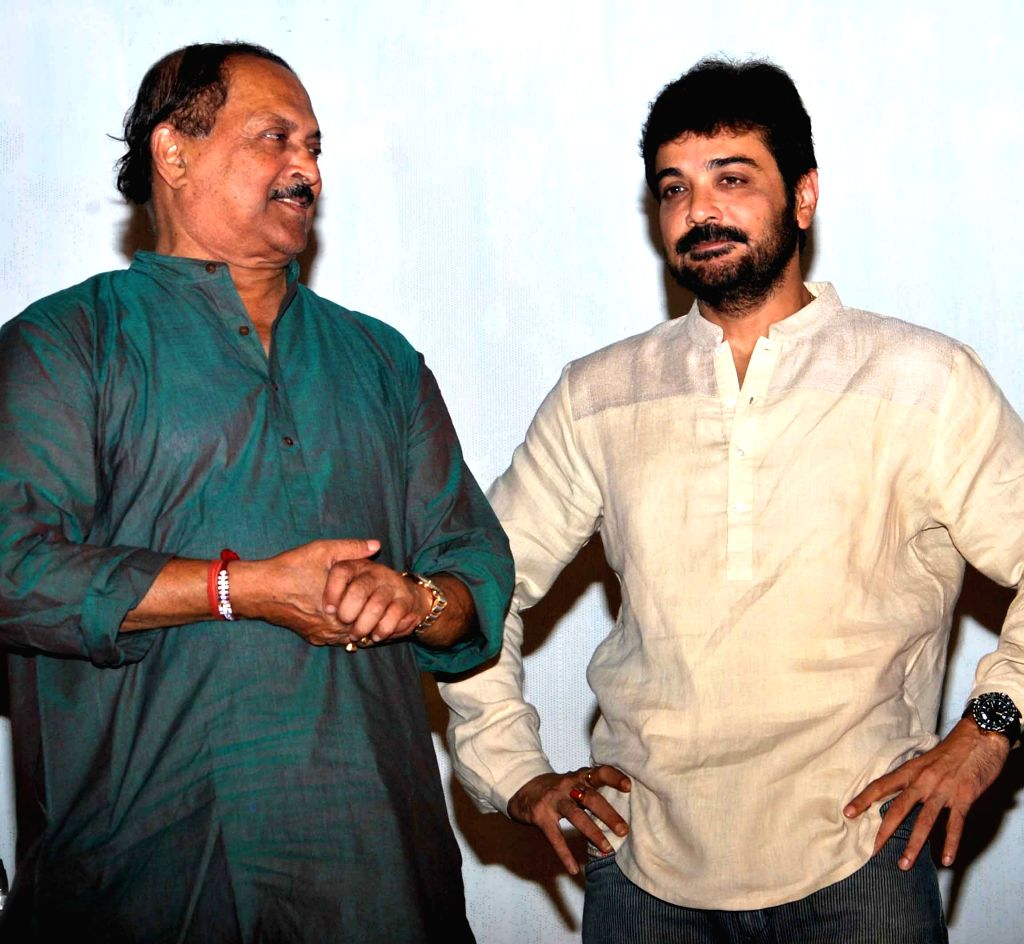 Actor Prosenjit Chatterjee with West Bengal panchayat minister Subrata Mukherjee at the launch of `Tochan Ghosh er Jalsha Ghar` - a book - in Kolkata on April 15, 2015. - Prosenjit Chatterjee and Subrata Mukherjee