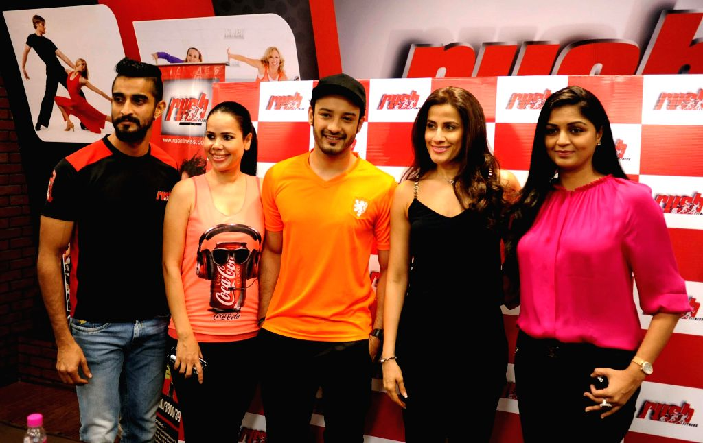 Actor Saheb Bhattacharya with celebrity fitness trainer Yasmin Karachiwala during the inauguration of a fitness centre in Alipore of Kolkata on March 10, 2015.