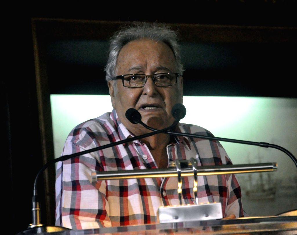"Kolkata: Actor Soumitra Chatterjee during inauguration of Nemai Ghosh's photo exhibition ""Satyajit Ray: The Many Moods of a Maestro"" in Kolkata, on May 30, 2017. (Photo: IANS) - Soumitra Chatterjee and Nemai Ghosh"