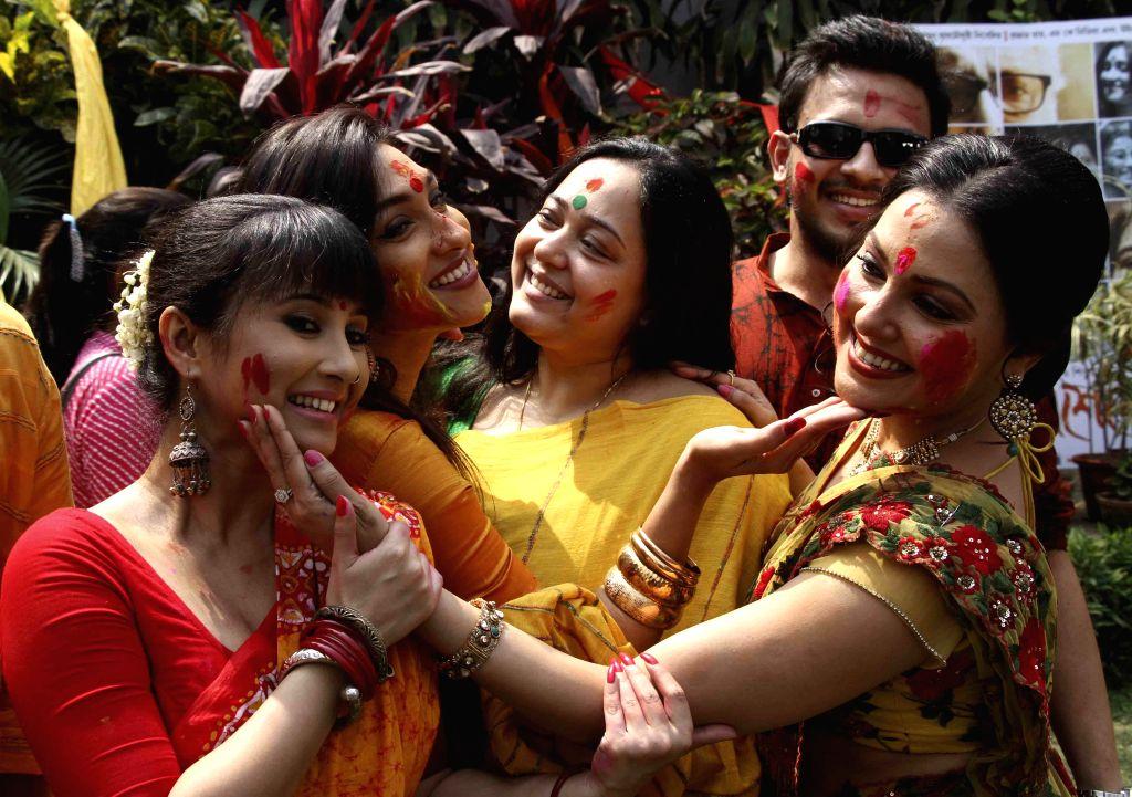 Actors Monami Chakroborty, Rituparna Sengupta, Aparajita Adhya and Indrani Dutta celebrate `Holi` in Kolkata, on March 3, 2015. - Monami Chakroborty, Rituparna Sengupta and Indrani Dutta