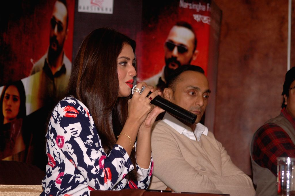 Actors Nusrat Jahan and Rahul Bose during a press conference to promote their upcoming film `Sondhey Naamar Aagey` (Bengali) in Kolkata, on Nov 26, 2014. - Nusrat Jahan and Rahul Bose