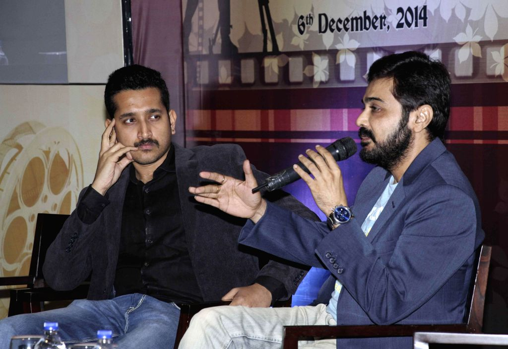 Actors Prosenjit Chatterjee and Parambrata Chatterjee during an interaction on Contemporary Bengali Cinema :  Impact and Future in Kolkata on 6 Dec, 2014. - Prosenjit Chatterjee and Parambrata Chatterjee