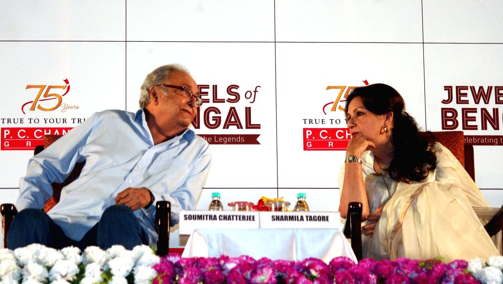 Actors Sharmila Tagore and  Soumitra Chatterjee during a programme organised to pay tribute to Satyajit Ray in Kolkata, on April 26, 2015.