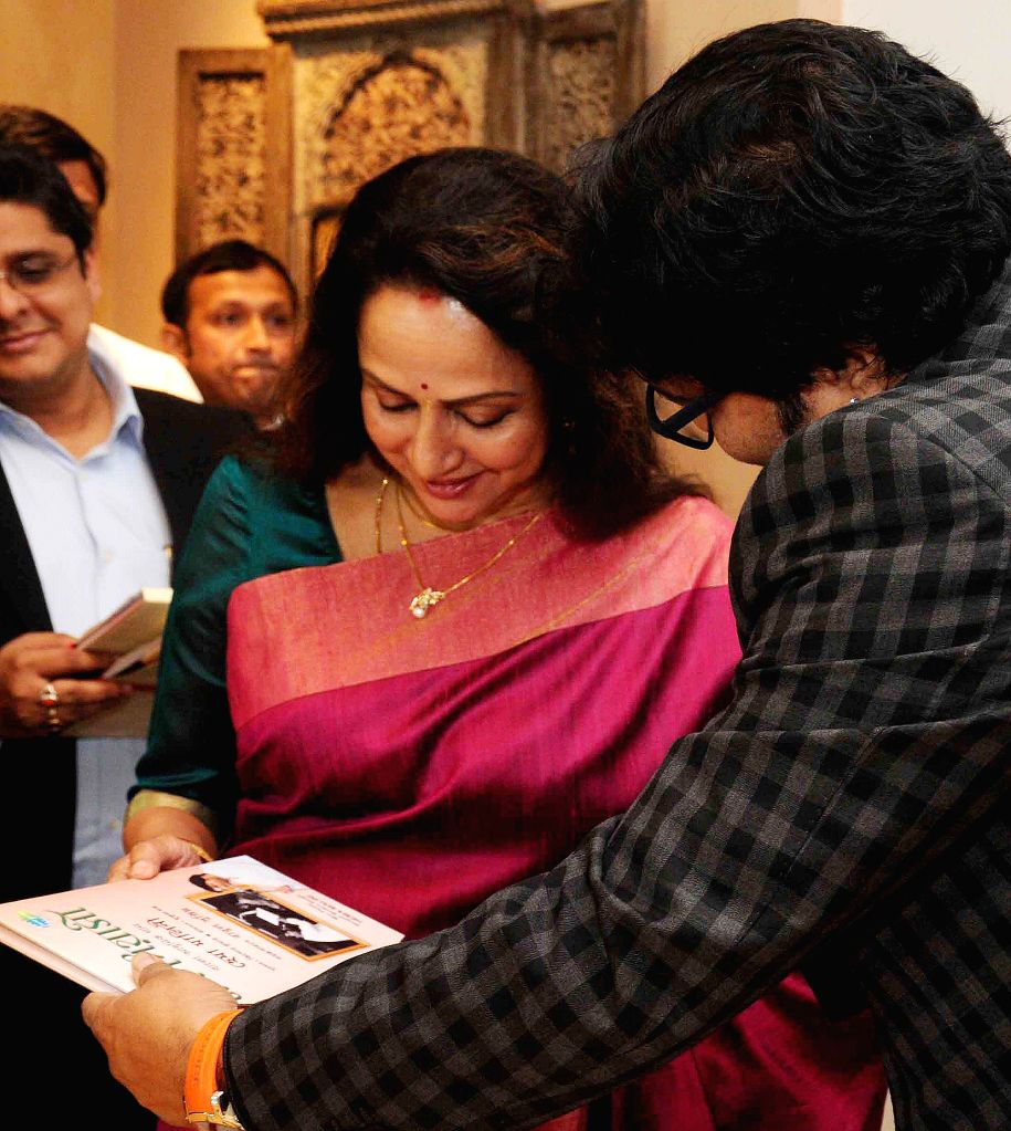 Actress Hema Malini with Union Minister of State for Urban Development, Housing and Urban Poverty Alleviation Babul Supriyo at the launch of her audio CD in Kolkata, on Jan 22, 2015.