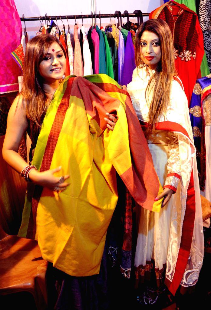 Actress Koneenica Banerjee with fashion designer Lopamudra Mandal Saha during an exhibition in Kolkata, on March 31, 2015.