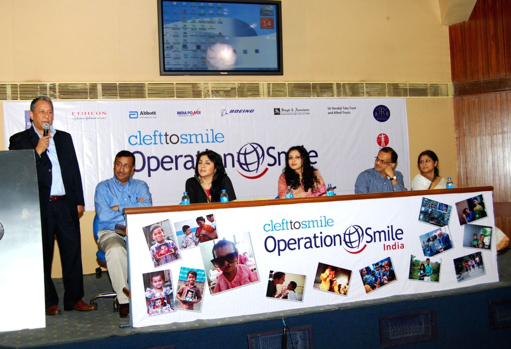 Actresses Locket Chatterjee, Nandana Sen, Roopa Ganguly and others during '5000 Smiles' - a programme organised by India Power Corporation Ltd in Kolkata, on Nov 14, 2014.