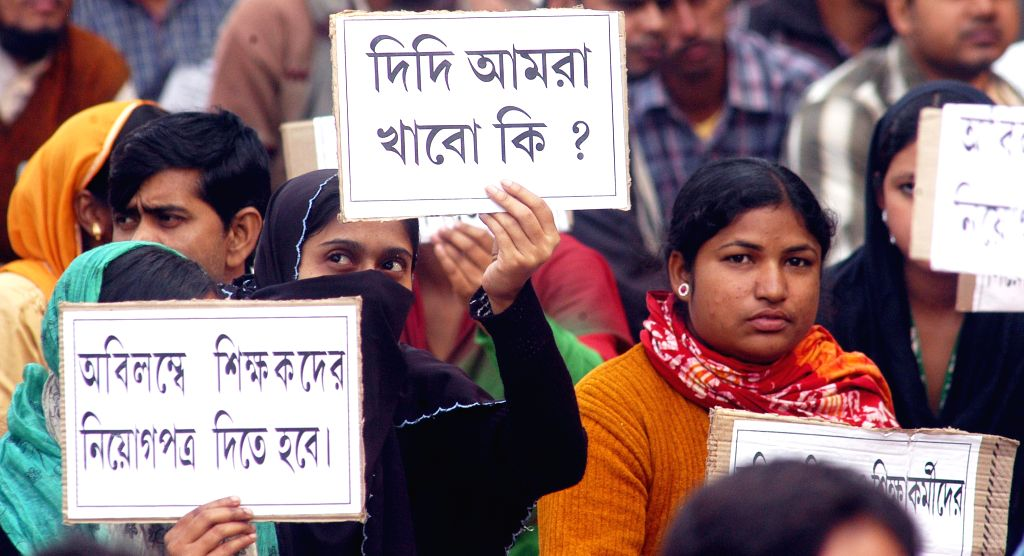All Bengal Minority Cell activists participate in a sit-in demonstration against West Bengal government in Kolkata on Dec 11, 2014.