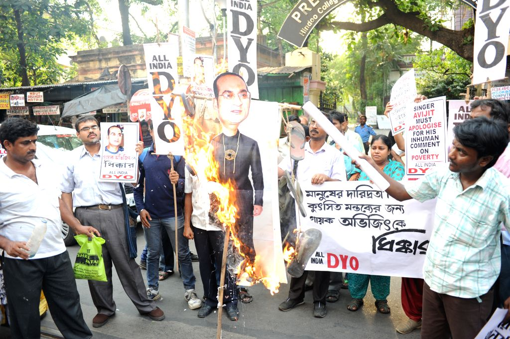 All India Democratic Youth Organization (AIDYO) activists stage a demonstration against singer Abhijeet Bhattacharya for his remarks on homeless in Kolkata, on May 7, 2015.