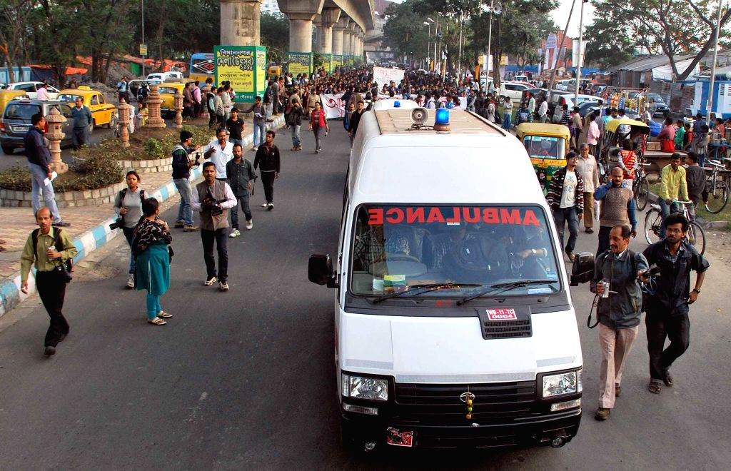 Ambulance carrying Jadavpur University students who are on fast until death participate in a rally against the vice chancellor of the varsity Avijit Chakraborty in Kolkata on Jan 9, 2015. - Avijit Chakraborty