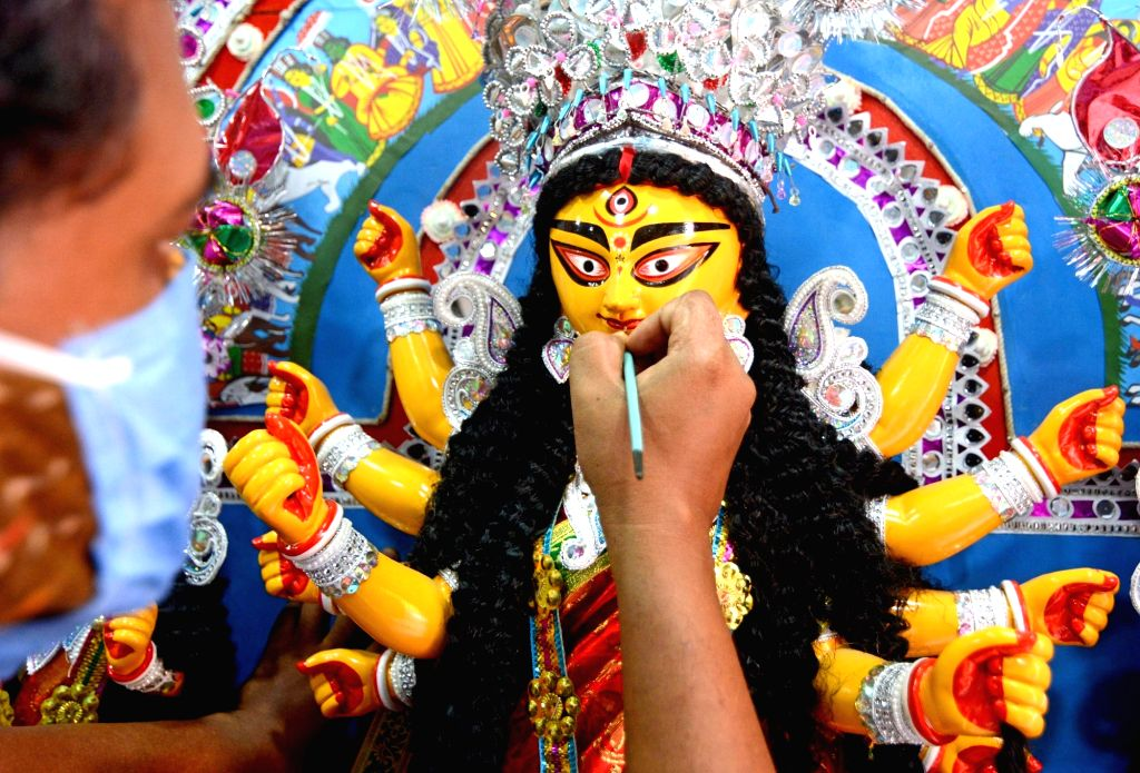 Kolkata: An artist busy giving finishing touches to an idol of Goddess Durga at Kumartuli workshop ahead of Durga Puja celebrations, in Kolkata on Oct 14, 2020. (Photo: Kuntal Chakrabarty/IANS)