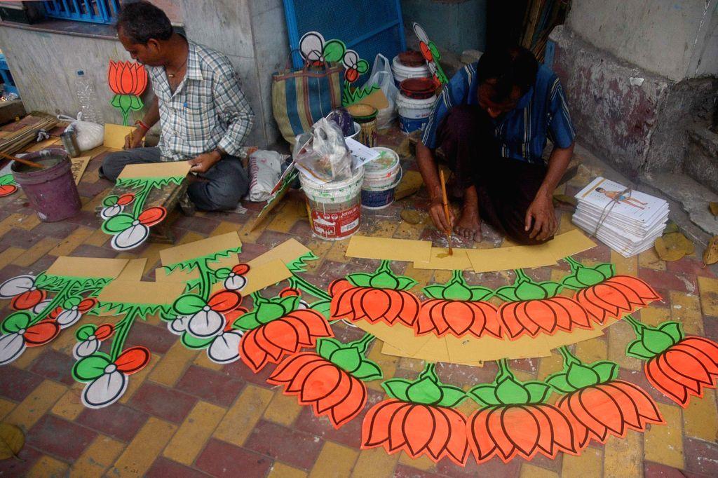 An artist busy making political symbols ahead of KMC polls in Kolkata on April 12, 2015.