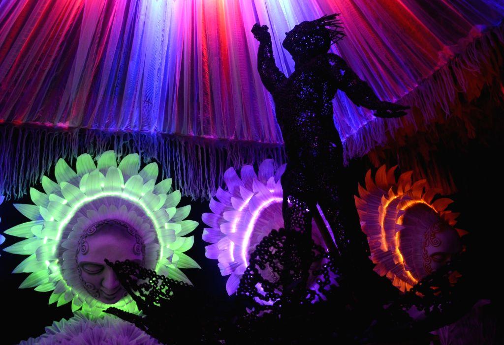 Kolkata : An artist working inside a Durga puja pandal ahead of Durga puja celebrations, in Kolkata on Oct 9, 2020.