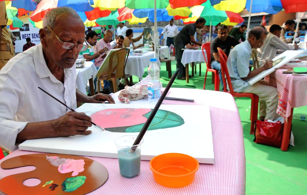 An inmate of Alipore Jail paints a picture during an art exhibition in Kolkata, on March 1, 2015.