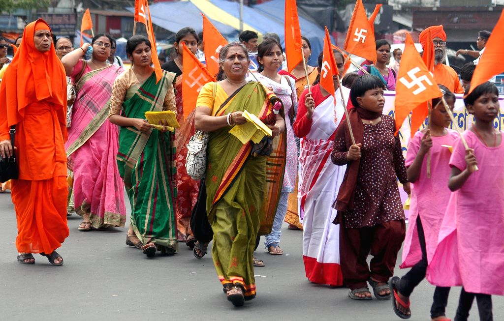 Anand Margis participate in a procession organised to observe the 95th birth anniversary of Anandamurti in Kolkata, on May 4, 2015.