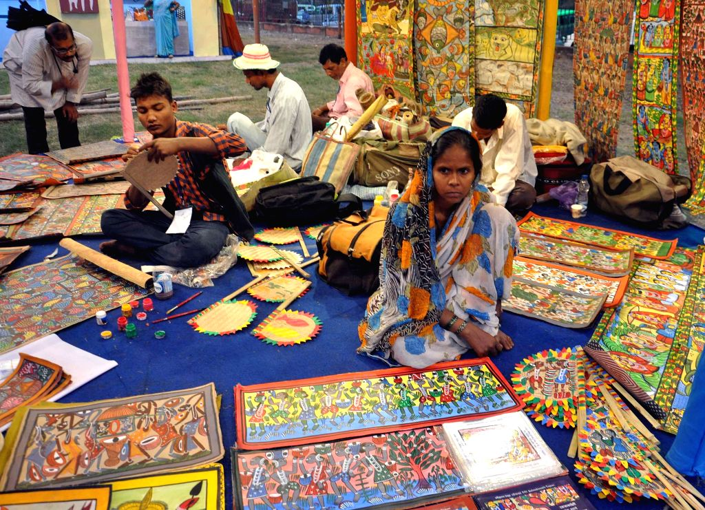 Artists busy painting at a stall of Sabala Mela - an initiative to strengthen the economically weaker sections - in Kolkata on Dec 5, 2014.
