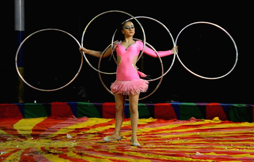 Artists demonstrate their skills during the Russian Empire Circus in Kolkata, on Dec 7, 2014.