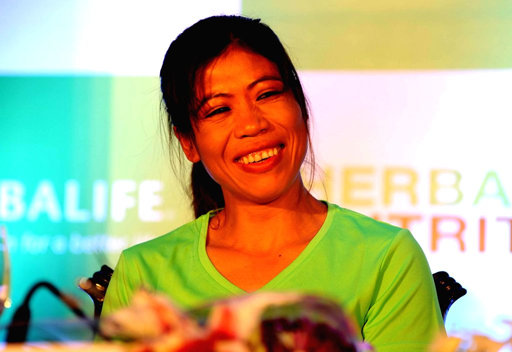 Asian Games medalist b oxer Mary Kom during a felicitation program for her excellent performance in Asian Games 2014, in Kolkata, on Nov 11, 2014. - Mary Kom