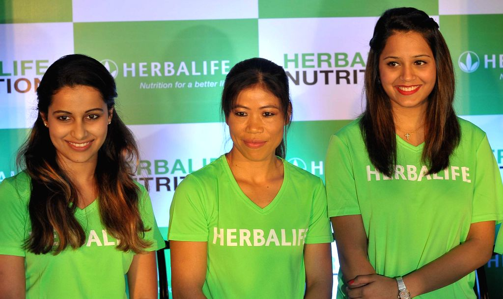 Asian Games medalists, pistol shooter Heena Sidhu, boxer Mary Kom and squash player Dipika Pallikal during a felicitation program for their excellent performance in Asian Games 2014, in ... - Mary Kom