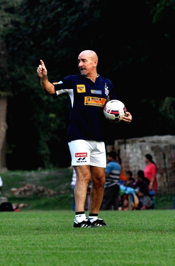 :Kolkata: Atletico de Kolkata coach Antonio Lopez Habas during a practice session in Kolkata on Nov. 4, 2015. .
