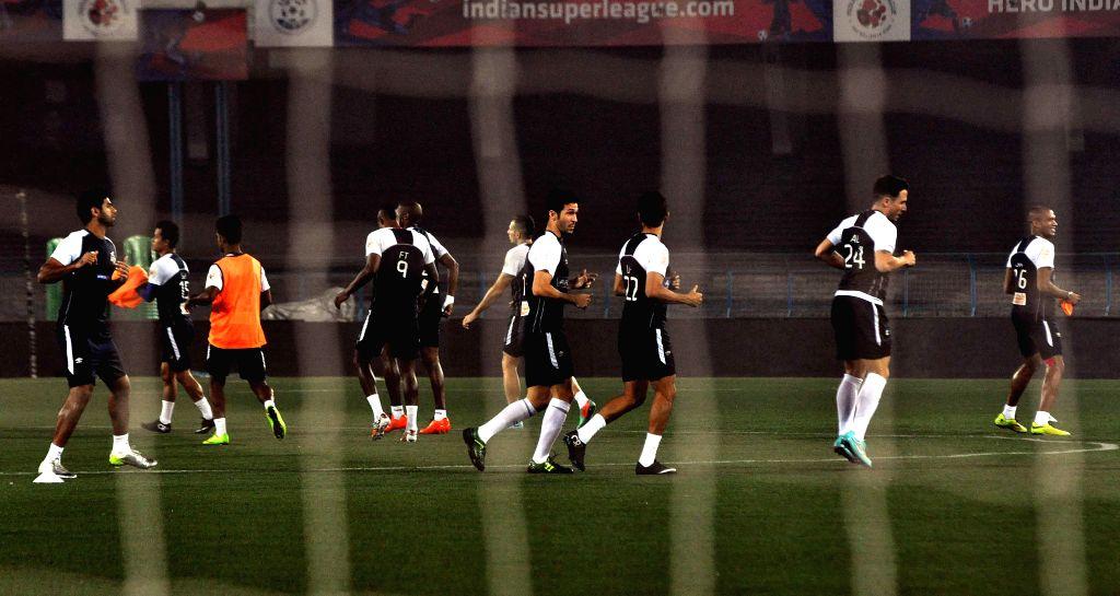 Atletico de Kolkata players during a practice session in Kolkata, on Dec 9, 2014.