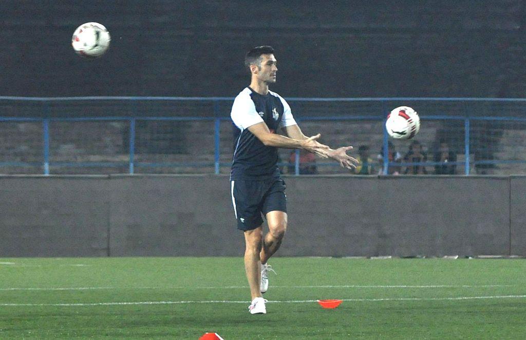 Atletico de Kolkata players in action during a practice session in Kolkata, on Nov 6, 2014.