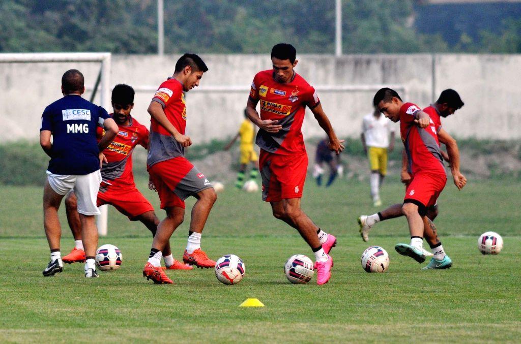 Kolkata: Atletico de Kolkata players in action during a practice session in Kolkata on Nov. 24, 2015.