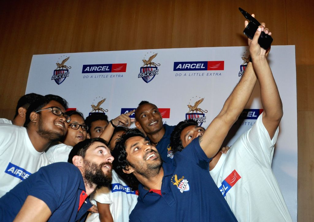 Atletico de Kolkata players Joffre Mateu Gonzalez, Fikru Tefera Lemessa and Subhasish Roy Chowdhury interact with students in Kolkata, on Nov 16, 2014. - Subhasish Roy Chowdhury