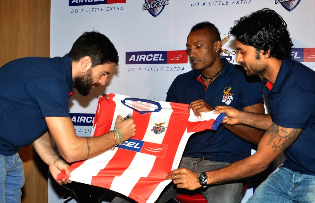 Atletico de Kolkata players Joffre Mateu Gonzalez, Fikru Tefera Lemessa and Subhasish Roy Chowdhury during an interaction with the students in Kolkata, on Nov 16, 2014. - Subhasish Roy Chowdhury